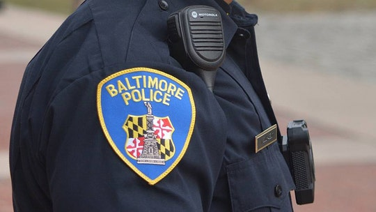 Baltimore officer investigated after video shows him coughing near public housing residents amid virus outbreak