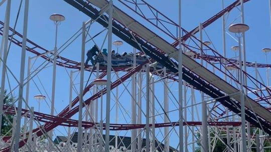 Panic strikes as school children get stuck near top of roller coaster
