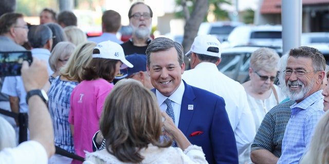 Fox News' Ed Henry chats with fans before the Fox Nation summit Tuesday in Arizona.
