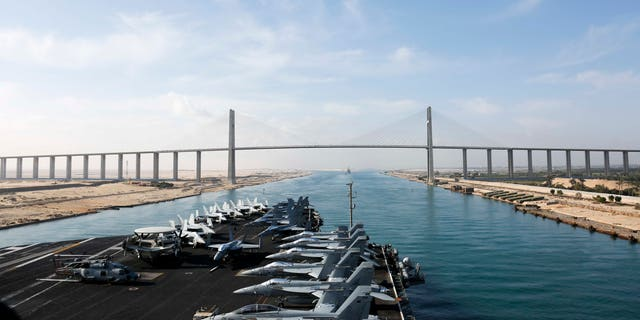 The Nimitz-class aircraft carrier USS Abraham Lincoln (CVN 72) transiting the Suez Canal.