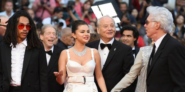 Actors Luka Sabbat, from left, Selena Gomez, Bill Murray, and director Jim Jarmusch pose for photographers upon arrival at the opening ceremony and the premiere of the film 'The Dead Don't Die' at the 72nd international film festival, Cannes, southern France, Tuesday, May 14, 2019. (AP)