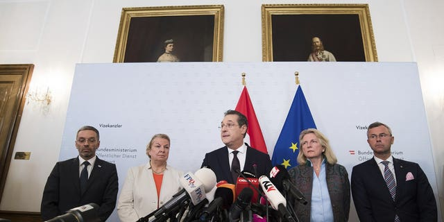 Austrian Vice Chancellor Heinz-Christian Strache (Austrian Freedom Party), center, addresses the media during press conference at the sport ministry in Vienna, Austria, Saturday, May 18, 2019. Strache says he is resigning after two German newspapers published footage of him apparently offering lucrative government contracts to a potential Russian benefactor.