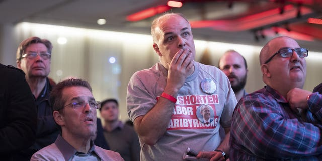 Labor party supporters watch the tally count at the Federal Labor Reception in Melbourne, Australia, Saturday, May. 18, 2019. Voting has closed in Australia's general election, with some senior opposition lawmakers confident that they will form a center-left government with a focus on slashing greenhouse gas emissions.