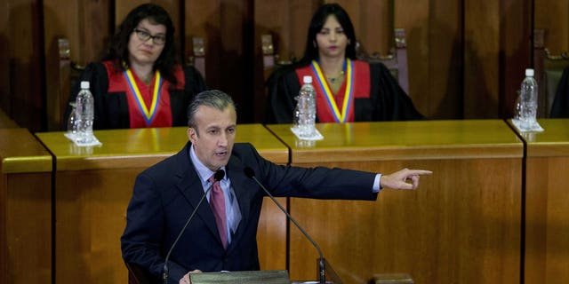 FILE - In this March 3, 2017 file photo, Venezuela's Vice President Tareck El Aissami, center, delivers his state of the nation report at the Supreme Court in Caracas, Venezuela. Charges were unsealed Friday, March 8, 2019 against the former Venezuelan vice president in New York federal court as authorities accused him of using his office to aid international drug traffickers.