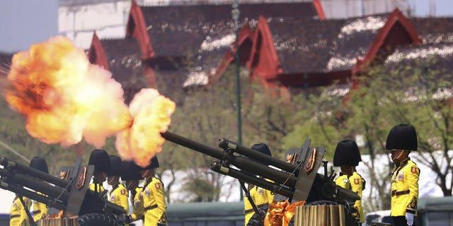 Royal Guards fire cannons in honour of Thailand's King Maha Vajiralongkorn Saturday, May 4, 2019, in Bangkok, Thailand.
