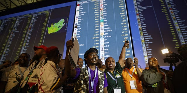 A gathering of representatives of smaller parties take to the stage to protest their claim that the elections were not free or fair, at the Independent Electoral Commission Results Center in Pretoria, South Africa, Thursday, May 9, 2019.