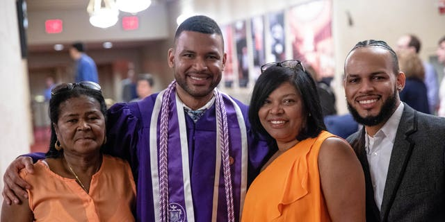 Frank Baez poses with family and friends after his graduation ceremony from the New York University Rory Meyers College of Nursing.