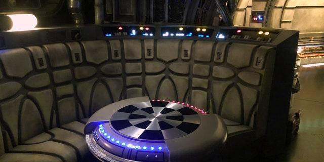 Once aboard, you and your crew wait in the ship's main hold and lounge, where you can sit at the holo-chess (Dejarik) table or inspect other equipment around the room (lots of Star Wars Easter Eggs here too).