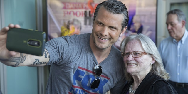 Pete Hegseth takes a picture with a loyal Fox News fan at the Fox Nation summit.