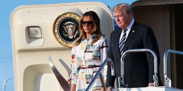 U.S. President Donald Trump, right, and first lady Melania Trump arrive at the Haneda International Airport Saturday, May 25, 2019, in Tokyo. (Associated Press)