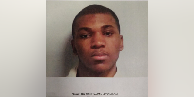 Darian Tawan Atkinson, 19, is accused of killing a Mississippi police officer outside the department's headquarters on Sunday night.