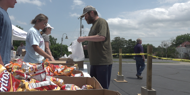 Volunteers at First Baptist Church in Fort Smith help distribute food