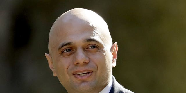 FILE - In this Tuesday, May 1 , 2018 file photo, Britain's newly appointed Home Secretary Sajid Javid arrives for a cabinet meeting at 10 Downing Street in London. Prime Minister Theresa May's announcement that she will leave 10 Downing Street has set off a fierce competition to succeed her as Conservative Party leader _ and as the next prime minister.