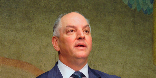 Christina Stephens, a spokeswoman for Louisiana Democratic Gov. John Bel Edwards (pictured), told Fox News the governor will sign an executive order Friday moving the election to the later date. The governor is also planning to hold a press conference in New Orleans on Friday. (AP Photo/Melinda Deslatte, File)