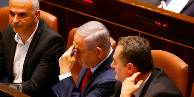 Israeli Prime Minister Benjamin Netanyahu before voting in the Knesset, Israel's parliament in Jerusalem, Wednesday, May 29, 2019. Israel's parliament has voted to dissolve itself, sending the country to an unprecedented second snap election this year as Prime Minister Benjamin Netanyahu failed to form a governing coalition before a midnight deadline.