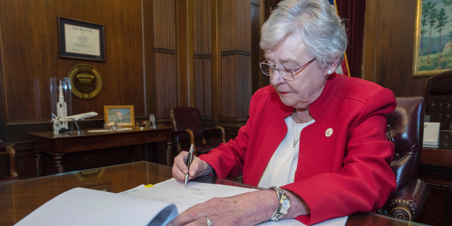 Alabama Gov. Kay Ivey signs the state's abortion bill into law, May 15, 2019, in Montgomery. Ala. Republicans who support the measure hope challenges to the law will be used by conservative justices on the U.S. Supreme Court to overturn the Roe v. Wade decision which legalized abortion nationwide. (Associated Press)