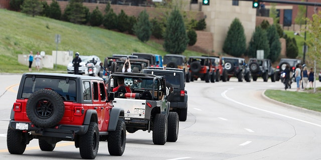 More than 600 Jeeps lead a caravan Wednesday, May 15, 2019 to the memorial service for Kendrick Castillo, who was killed in the assault on the STEM Highlands Ranch School, in Highlands Ranch, Colo. (AP Photo/David Zalubowski)