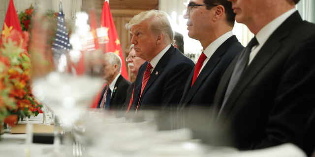President Trump and Treasury Secretary Steve Mnuchin, second from right, listening to remarks by Chinese President Xi Jinping during a bilateral meeting at the G20 Summit in December 2018. (AP Photo/Pablo Martinez Monsivais, File))