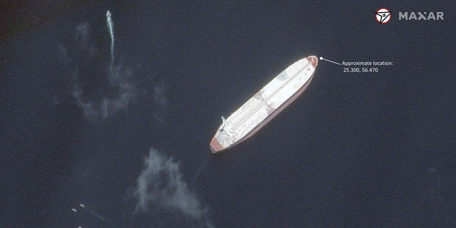 """This satellite image provided by Maxar Technologies shows the Saudi-flagged oil tanker Amjad off the coast of Fujairah, United Arab Emirates, Monday, May 13, 2019. As many as four oil tankers anchored in the Mideast were damaged in what Gulf officials described Monday as a """"sabotage"""" attack off the coast of the United Arab Emirates. (Satellite image ©2019 Maxar Technologies via AP)"""
