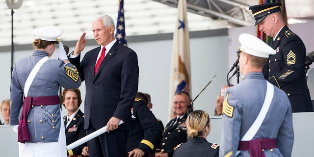 Vice President Mike Pence salutes a graduating cadet before handing a diploma to her during graduation ceremonies at the United States Military Academy, Saturday, May 25, 2019, in West Point, N.Y. (AP Photo/Julius Constantine Motal)