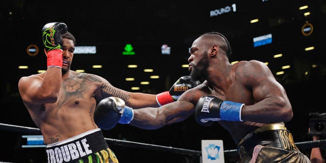 Dominic Breazeale, left, evades a right from Deontay Wilder during the first round of the WBC heavyweight championship boxing match Saturday, May 18, 2019, in New York. Wilder won in the first round.