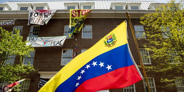 Clashing protesters outside the Venezuelan Embassy in Washington late last month. (AP Photo/Andrew Harnik)
