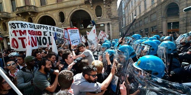Protesters confront police officers when riots broke out on Wednesday, May 1, 2019, during a rally on May 1 in Turin, Italy.