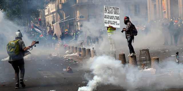 Tear gas canisters lie on the ground during a May Day demonstration in Paris, Wednesday, May 1, 2019. Brief scuffles between police and protesters have broken out in Paris as thousands of people gather for May Day rallies under tight security measures. Police used tear gas to control the crowd gathering near Paris' Montparnasse train station. (AP Photo/Francois Mori)