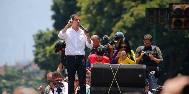 Opposition leader Juan Guaidó speaks to supporters in Caracas, Venezuela, Wednesday, May 1, 2019. Thousands gathered to demand President Nicolas Maduro's ouster in what could be another critical day in the nation's struggle between a widely detested socialist government and an opposition backed by powerful allies like the United States but unable to secure the loyalty of key factions like the military. (AP Photo/Fernando Llano)