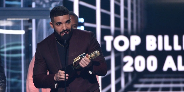 """Drake accepts the top billboard 200 album award for """"Scorpion"""" at the Billboard Music Awards on Wednesday, May 1, 2019, at the MGM Grand Garden Arena in Las Vegas."""