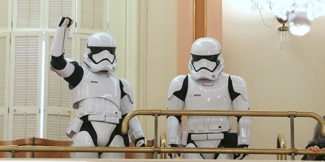"""A pair of stormtroopers watch lawmakers in action from the gallery of the state Senate chambers on Thursday in Sacramento, Calif. The California Legislature voted to declare May 4 """"Star Wars Day."""""""