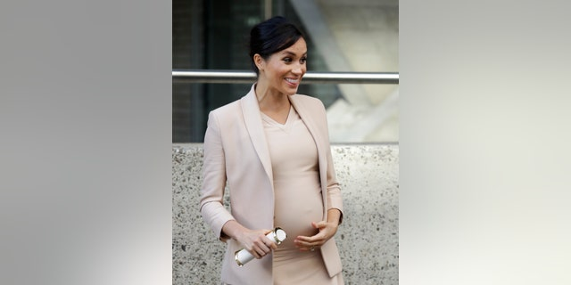 In this file photo dated Wednesday, Jan. 30, 2019, Britain's Meghan, The Duchess of Sussex, leaves after visiting the National Theatre in London. Buckingham Palace said Monday May 6, 2019, that Prince Harry's wife Meghan welcomed a baby boy.