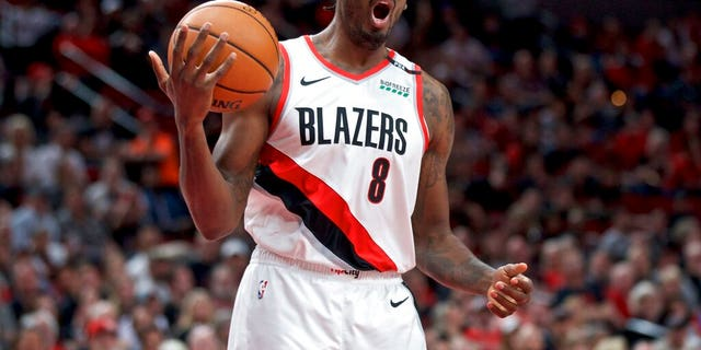 Portland Trail Blazers forward Al-Farouq Aminu reacts after being called for a foul against the Denver Nuggets during overtime of Game 3 of an NBA basketball second-round playoff series Friday, May 3, 2019, in Portland, Ore.