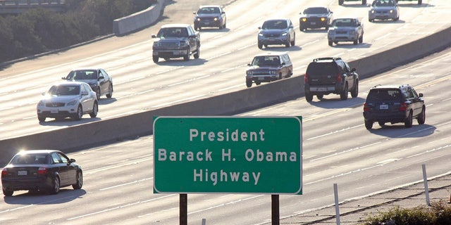 In this Thursday Dec. 20, 2018, file photo, signs have gone up naming a section of a Los Angeles-area freeway as the President Barack H. Obama Highway, seen from Pasadena, Calif. (Associated Press)