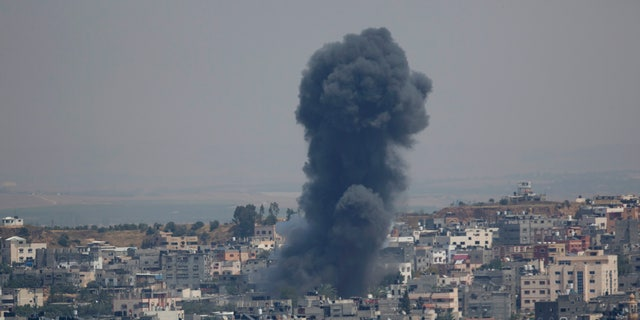 Smoke rises from an explosion after an Israeli airstrike in Gaza City, Sunday, May 5, 2019. The Israeli military said Sunday it had responded to 450 rockets fired from Gaza with over 250 airstrikes against the besieged Palestinian enclave. (AP Photo/Hatem Moussa)