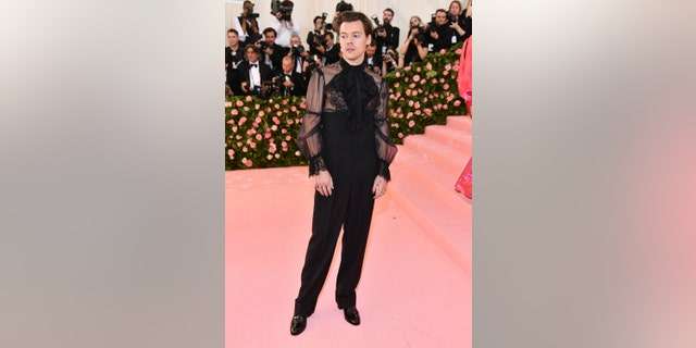 Harry Styles, in a Gucci outfit, makes his Met Gala debut.