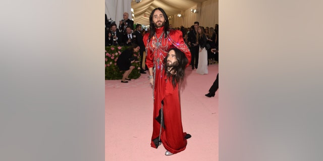 Jared Leto, holding a model of his own head, attends the 2019 Met Gala in New York City.