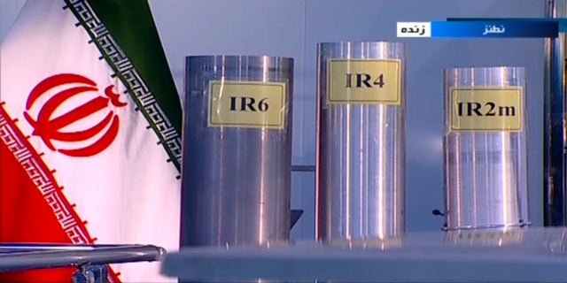 FILE - In this June 6, 2018 frame grab from Islamic Republic Iran Broadcasting, IRIB, state-run TV, three versions of domestically-built centrifuges are shown in a live TV program from Natanz, an Iranian uranium enrichment plant, in Iran.