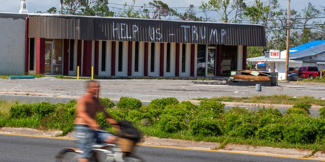 FILE: A cyclist rides by a building damaged by Hurricane Michael in Parker, Fla. Residents in these parts of the Florida Panhandle that were devastated by Hurricane Michael six months ago. (Associated Press)