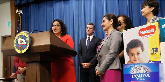 Assemblywoman Cristina Garcia discusses the proposal by Gov. Gavin Newsom, second from left, to eliminate the state sales tax on tampons and diapers in his upcoming state budget during a news conference Tuesday. (Associated Press)