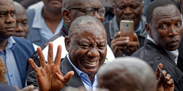 President Cyril Ramaphosa greets supporters after casting his vote at the Hitekani Primary School in Soweto, Johannesburg, South Africa Wednesday, May 8, 2019.