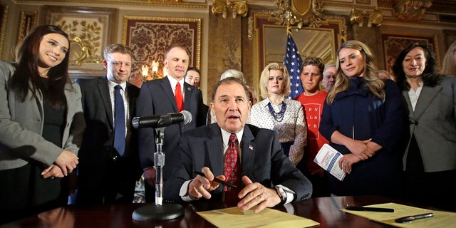 Utah Gov. Gary Herbert looks up during a ceremonial signing of a state resolution declaring pornography a public health crisis, at the Statehouse in Salt Lake City, April 19, 2016. (Associated Press)