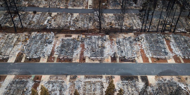 This Dec. 3 photo shows homes leveled by the Camp Fire line the Ridgewood Mobile Home Park retirement community in Paradise, Calif. (Associated Press)