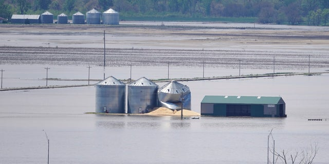 Grain bins stand in floodwaters from the Missouri River, in Hamburg, Iowa, on May 10. (AP Photo/Nati Harnik, File)