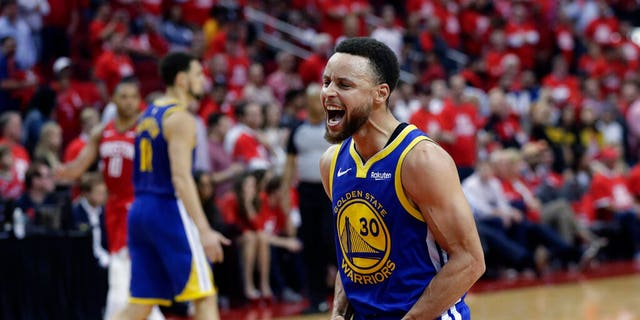 Golden State Warriors guard Stephen Curry (30) celebrates the team's win over the Houston Rockets in Game 6 of a second-round NBA basketball playoff series, Friday, May 10, 2019, in Houston. Golden State won 118-113, winning the series. (AP Photo/Eric Gay)