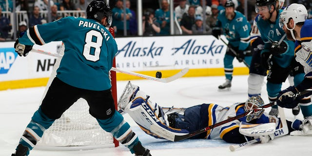San Jose Sharks' Joe Pavelski (8) scores a goal against St. Louis Blues goaltender Jordan Binnington (50) in the first period in Game 1 of the NHL hockey Stanley Cup Western Conference finals in San Jose, Calif., on Saturday. (Associated Press)