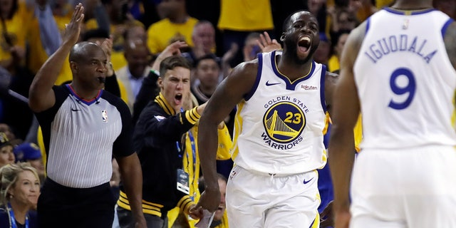 Golden State Warriors' Draymond Green (23) celebrates a score against the Portland Trail Blazers during the second half of Game 1 of the NBA basketball playoffs Western Conference finals Tuesday, May 14, 2019, in Oakland, Calif.