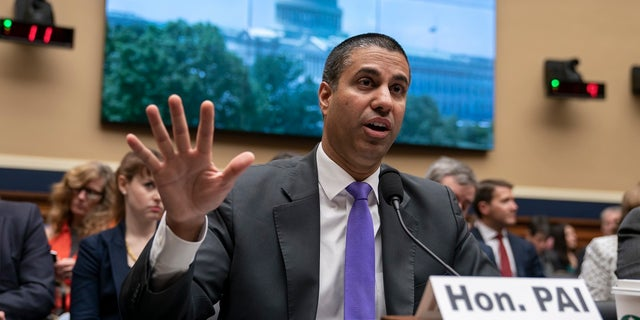 Ajit Pai, head of the Federal Communications Commission, witnesses as the House Energy and Commerce Committee holds a FCC audit, on Capitol Hill in Washington, Wednesday, May 15, 2019. (AP Photo / J. Scott Applewhite)