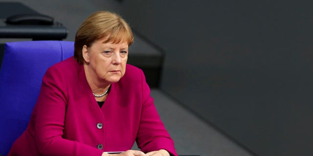 German Chancellor Angela Merkel attends a discuss during a Reichstag building in Berlin, Germany, Thursday, May 16, 2019.