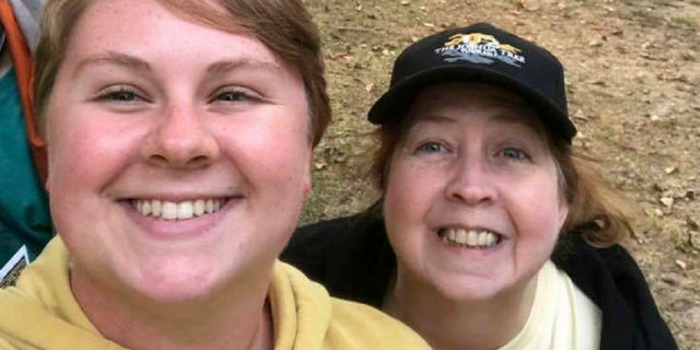 In this 2018 photo provided by Virginia Black, Alex Black, left, poses for a photo with her aunt Virginia. Alex Black was killed in November 2018 when she came face to face with an escaped lion just 10 days into her unpaid internship at the Conservators Center in Burlington, N.C. (Virginia Black via AP)